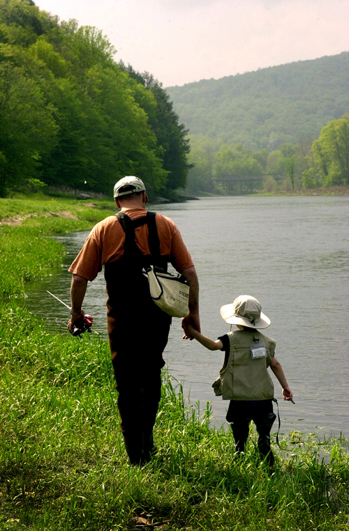 The Fishermen. Like father like son. Maybe the little boy dreams of catching the biggist fish in the Delaware River and the father's dream is gently remembering the first time he went out fishing with his own father. The scene is on the Delaware River somewhere between Callicoon and Hankins, N.Y.