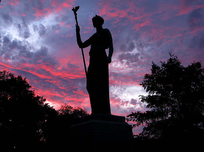 DAWN'S EARLY LIGHT - Dawn's early light brings fourth a mystical silhouette of the World War I memorial statue, sculptured by the renowned Paterson artist, Gaetano Feferici, (1880-1964). The bronze statue is mounted on a granite block at Westside Park, Paterson N.J.