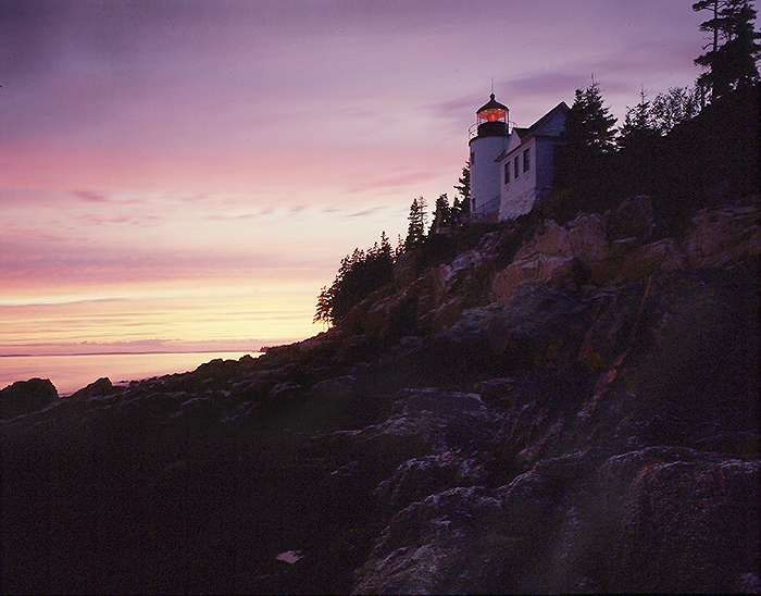 SEEING THE LIGHT - The towering lighthouse sends out it's beam of  light, like the many stars in the heaven, keeping watch in the darkness for the mariner in his small boat.