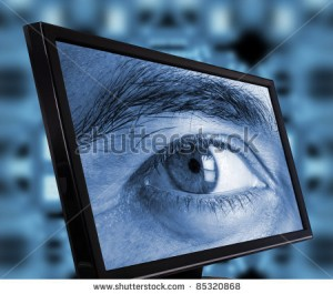 stock-photo-eye-spying-trough-a-computer-monitor-85320868