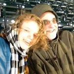 Daughter Sadie and the author huddle for warmth during Cardinals-Mets game Wednesday night..