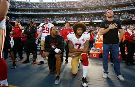 Colin Kaeperneck ... kneeling to make a point