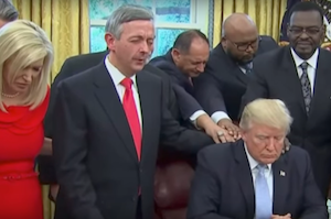Is he praying in this photo? For what?